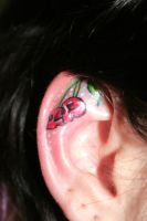 Cherry Ear Skull Tattoo by 2Face-Tattoo