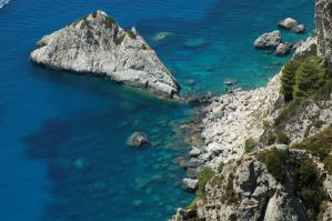 Rock in the blue Sea by PublicOppinion