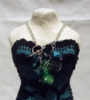 teal green and silver charm necklace by ACrowsCollection