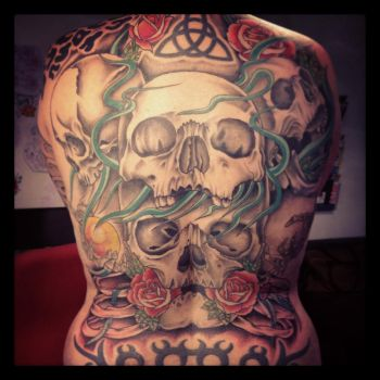 Big skull back tattoo by Unibody