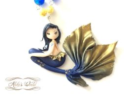 Gold and blue mermaid by Akiko-s-World