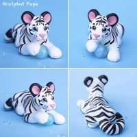 White tiger cub with ice crystal sculpture by SculptedPups