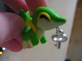 Snivy with a key by FlameTheFlareon