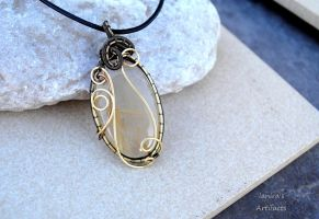 Gold rutilated quartz wire wrapped pendant by IanirasArtifacts