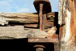 Close up of the rusting pier at St Annes by lazylikesunday