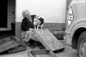 Fishwoman and her dog by Ijgg