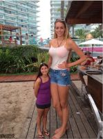 Tall girl with short woman by lowerrider