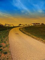 A road, a village and a sunset by patrickjobst