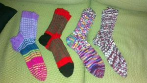 Four pairs of scrap yarn socks by KnitLizzy