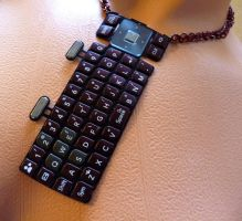 Red Cell Phone Keypad Necklace by Divulged