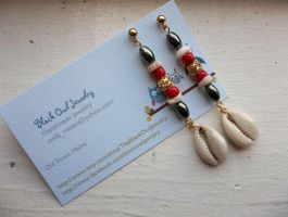 Chango earrings by IdolRebel