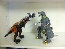 Movie Grimlock and G1 Grimlock Dinobot mode by darthraner83