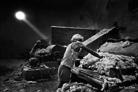 Workers in a cotton warehouse. by joetlchan