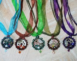 Steampunk bottle cap necklaces by SuperFlashDance