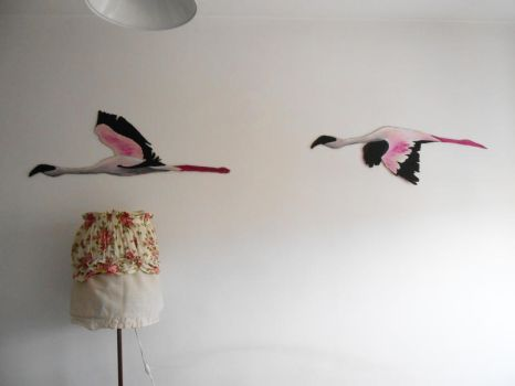 Flamingos on wall by Sikorax