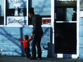 a woman and her child on the street by chanmanthechinaman