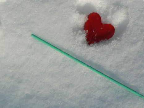 broken popsicle on snow by Clairei