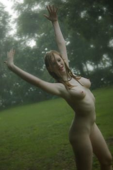 Dancing Naked in the Rain by nikongriffin