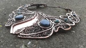 Copper wire wrapped necklace Sold! by TangledWorld