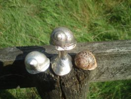 snail casting, pewter and brass. by Spoondryft