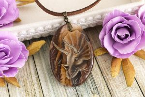 Triceratops - handmade painted stone pendant by LunarFerns