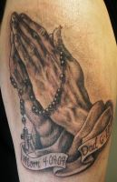 praying hands tattoo by JWheelwrighttattoos