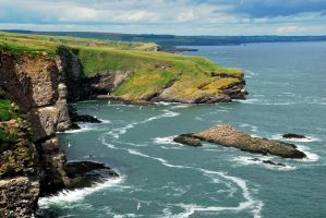 A rocky coastline in Scotland by jchanders