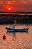 Boat at sunset, Teesmouth by steveearl