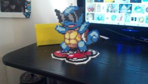 Squirtle on a tri-pokeball tiered base. by AstralElement