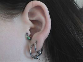 Tragus Piercing by bad-ass