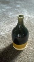 yellow brown and black bottle by cmckoy