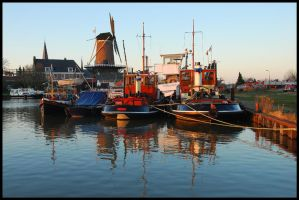 Resting in a December harbour by jchanders