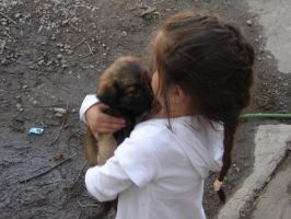 Girl and Puppy by Fotohunter