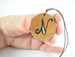 Wood burned initial necklace by Amaltheea