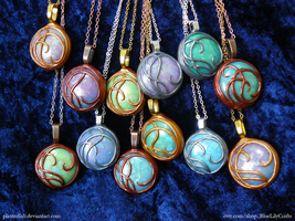 Polymer Clay Pendants by plasterfish