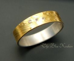 silver/gold bi-metal ring with moissanites by thebluekraken