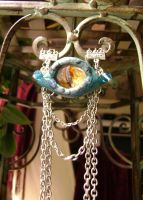 Teal Dragon Eye Necklace by RaPVVNzel