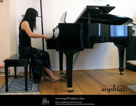 stock 610: playing piano by sophiaastock