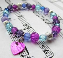 Blue and purple bracelet with heart charm by TerraNovaJewels