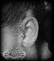 Triple forward helix by state-of-art-tattoo