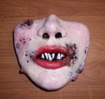 Poorly done Sculpey face piece by pink-porcupine