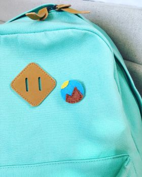 Mountain Felt Pin on backpack by Madylyne