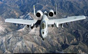 A-10 Thunderbolt II Flying over some mountains by jamestayloranime