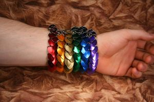 rainbow of scale bracelets by DracoLoricatus