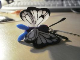 butterfree earring by ChibiLinda