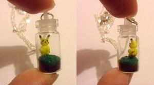 tiny pikachu in a jar by Stefimoose