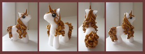 Goldy Unicorn by calie-coco