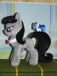 Octavia Melody plush and a small vinyl by My-Little-Plush