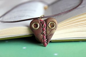 Broken heart steampunk necklace by Sakiyo-chan
