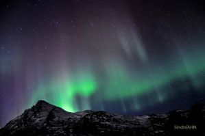Auroras above Mjelle-Peak 1 by SindreAHN